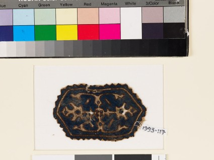 Textile fragment with hexagon, two palmettes, and leavesfront