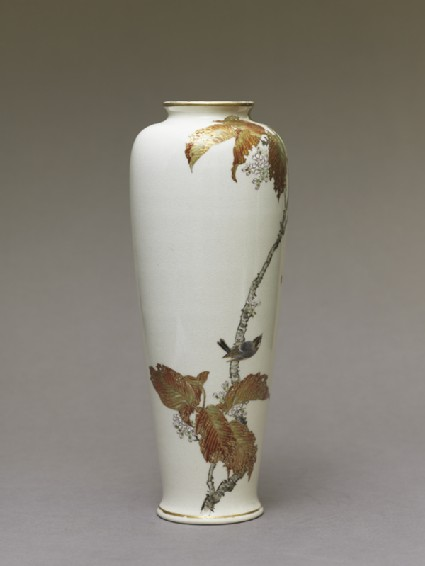 Satsuma style vase depicting a bird perched on a cherry treeside