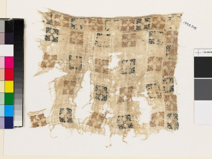 Textile fragment with squares and flower-headsfront