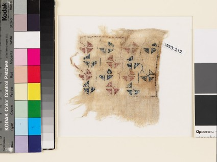 Textile fragment with geometric flowers and stemsfront