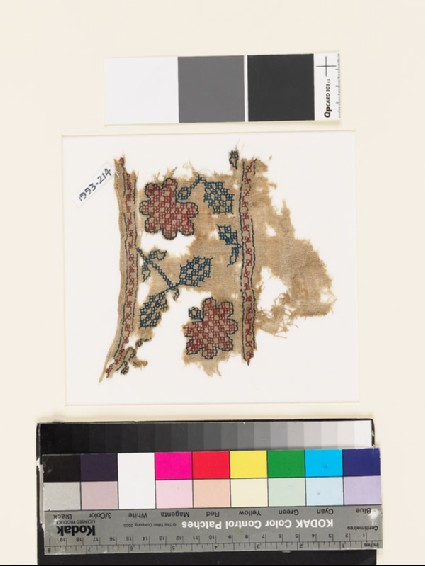 Textile fragment with stylized flowers, leaves, and squaresfront