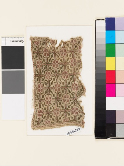 Textile fragment with lattice of diamond-shapes and squaresfront