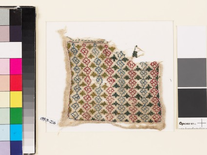Textile fragment with linked rosettes and leavesfront