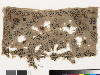 Textile fragment with remains of a roundel, octagon, square, and plant shapesfront