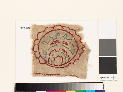 Textile fragment with multi-petalled circle and leaffront