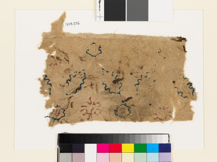 Textile fragment with rosettes and leavesfront