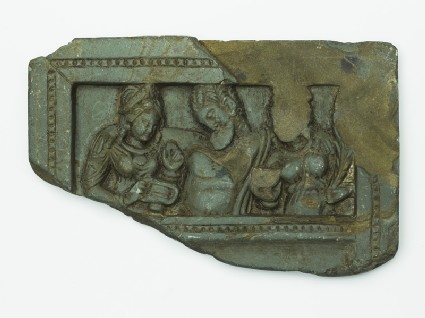 Lid or palette with the drunken Heracles supported by two female attendantstop