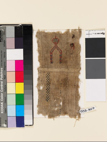 Textile fragment with V-shape, geometric band, and check pattern, probably from a samplerfront
