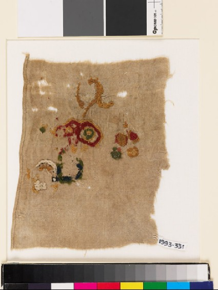 Textile fragment with incomplete floral shapesfront