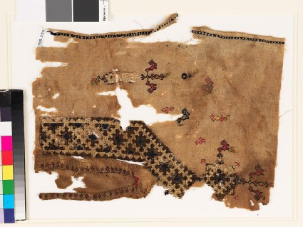 Textile fragment from the neck of a tunic with a V-shape, birds, and plantsfront