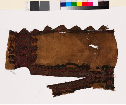 Textile fragment from the neck of a dress with stylized floral shapesfront