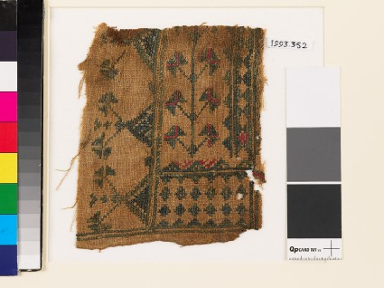 Textile fragment with stylized flowers, diamond-shapes, and trianglesfront