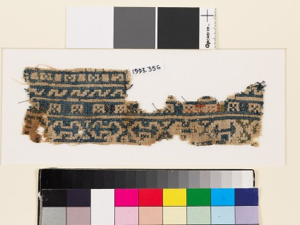 Textile fragment with bands of arrowheads, squares, and Z-shapesfront