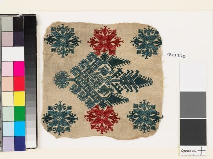 Textile fragment with an elaborate medallion, trees, birds, and flowersfront