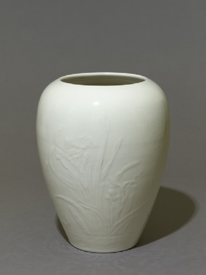 Vase with narcissi and a wagtailoblique