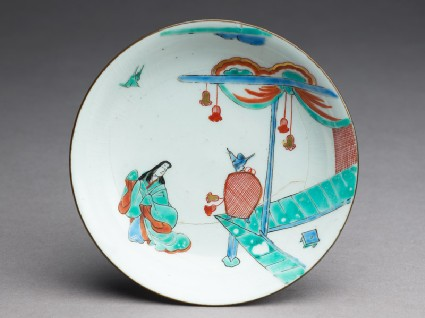 Saucer depicting a woman in Heian period dress with a birdtop
