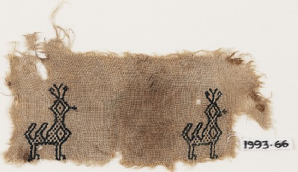 Textile fragment with two peacocksfront