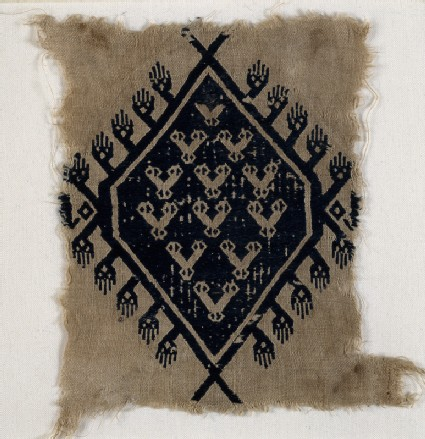 Textile fragment with hands and diamond-shaped medallionfront