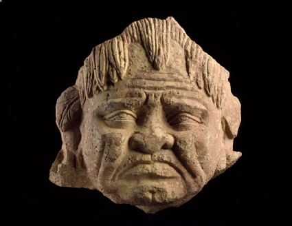 Head of a grimacing yaksha, or nature spiritfront