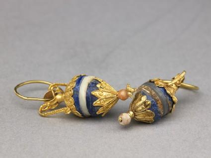 Gold earrings with lapis lazuli, ivory, and quartz pendantsoblique