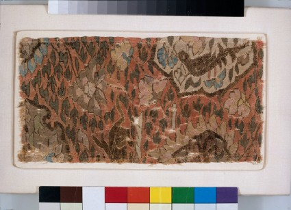 Tapestry fragment with bird, beast, and peoniesfront