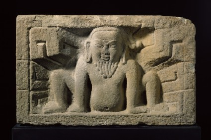 Stone slab with yaksha, or nature spirit, in relieffront