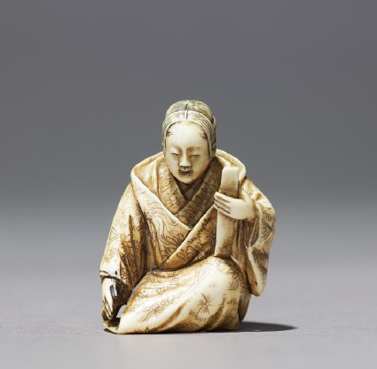Netsuke in the form of a Nō actor wearing a maskfront