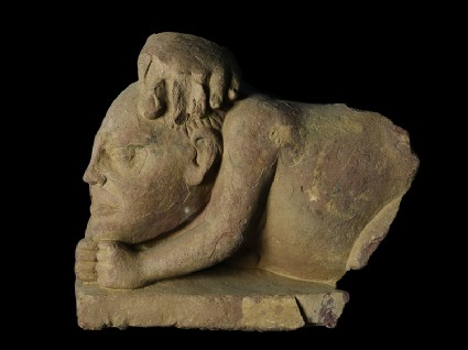 Fragmentary figure of a crouching yaksha, or nature spiritfront