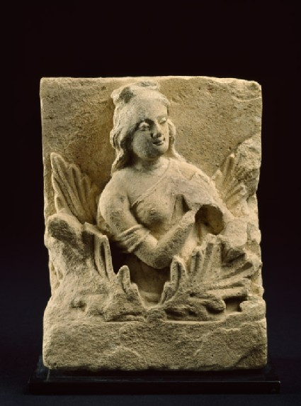 Frieze fragment depicting a female attendant among acanthus leavesfront