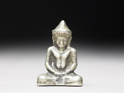 Silver amulet in the form of the Buddhafront