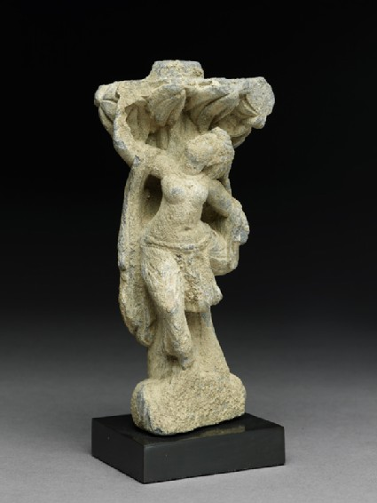 Relief fragment depicting a female dancer beneath a treeside