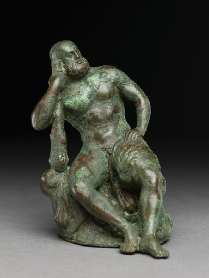 Figure of the hero god Heracles with his club seated on a lionfront