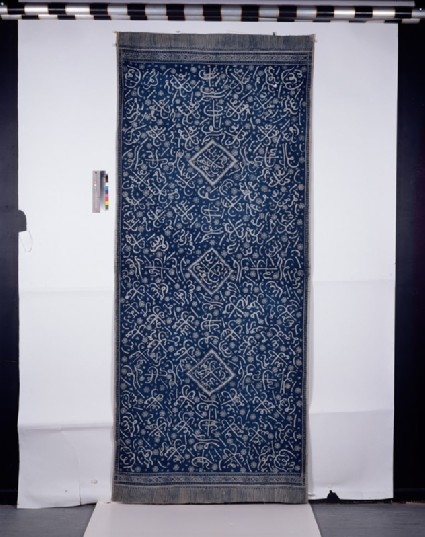 Hiasan dinding, or ceremonial wall hanging, with Islamic calligraphic and floral decorationfront
