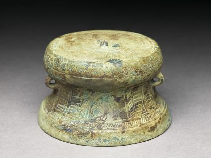 Small bronze drumoblique