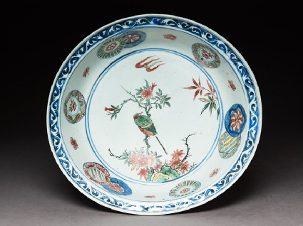 Dish with a bird on a flowering branchtop