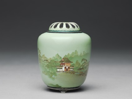 Incense burner, or kōro, with an entrance gate amid treesside