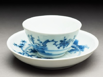 Cup and saucer with leaping tigersoblique