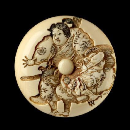 Manjū netsuke depicting Minamoto Yoshitsune practising martial arts with a tengu demonfront