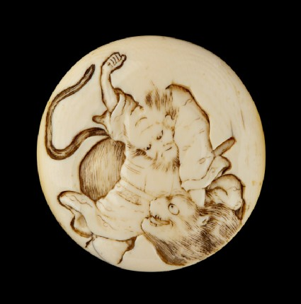 Manjū netsuke depicting Sanbushō fighting a tigerfront