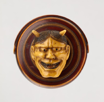 Manjū netsuke in the form of a temple gong and Hannya mask from the Nō play 'Dōjōji'front
