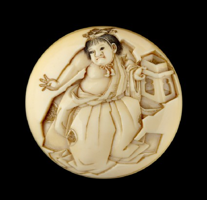 Manjū netsuke depicting a boy throwing beans at the Setsubun festivalfront