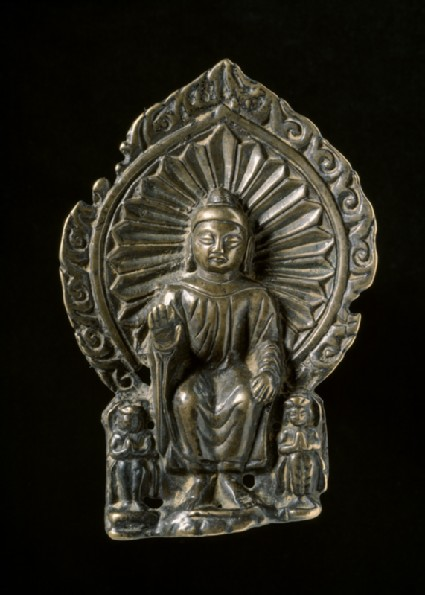 Seated figure of the Buddha with attendantsfront
