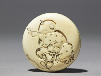 Manjū netsuke with a boy playing with a spinning topfront