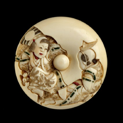 Manjū netsuke depicting a Sanbasō dancer and mask box bearer, with an uprooted pine sapling on the reversefront