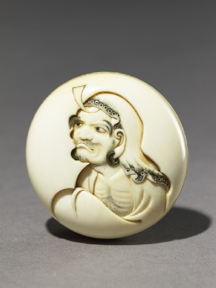 Manjū netsuke depicting Daruma playing the kamifuki gamefront