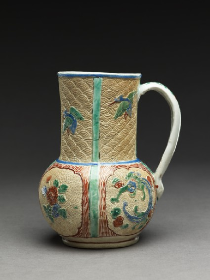 Mug of European form with dragons, flowers, and birdsside
