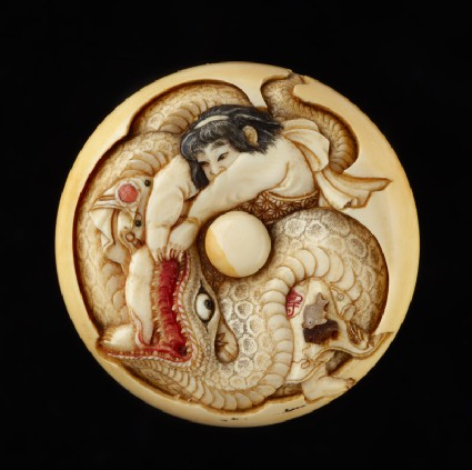 Manjū netsuke depicting Kintarō wrestling with a snakefront