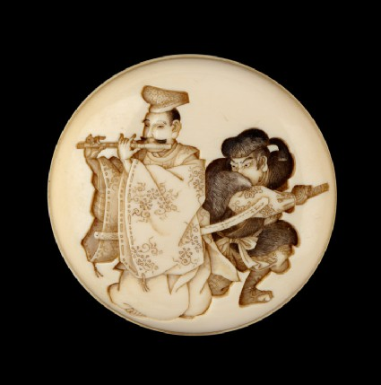 Manjū netsuke depicting Yasumasa playing his flute about to be attacked by the bandit Hakadamarefront