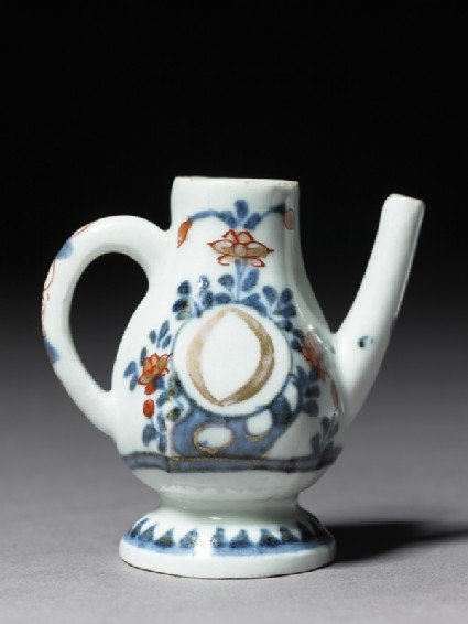 Miniature oil ewer marked with the letter 'O'side