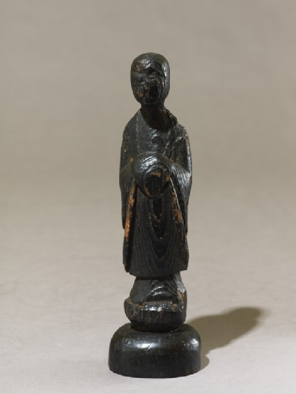 Standing Buddhist figureoblique
